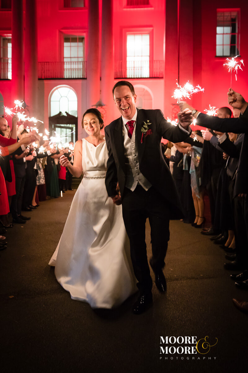 Sparklers - winter wedding. Bride and Groom Portraits. Wedding Photography at Beaumont House, Windsor