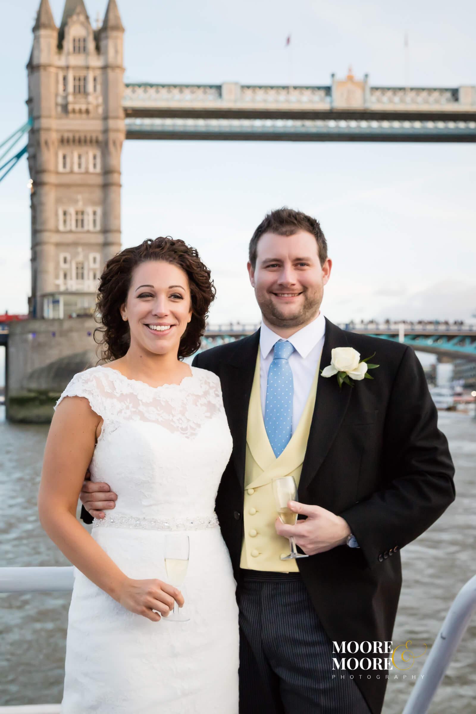 Bride and groom by Tower Bridge wedding photos by Moore&Moore Photography, Wedding Photographer Hampshire