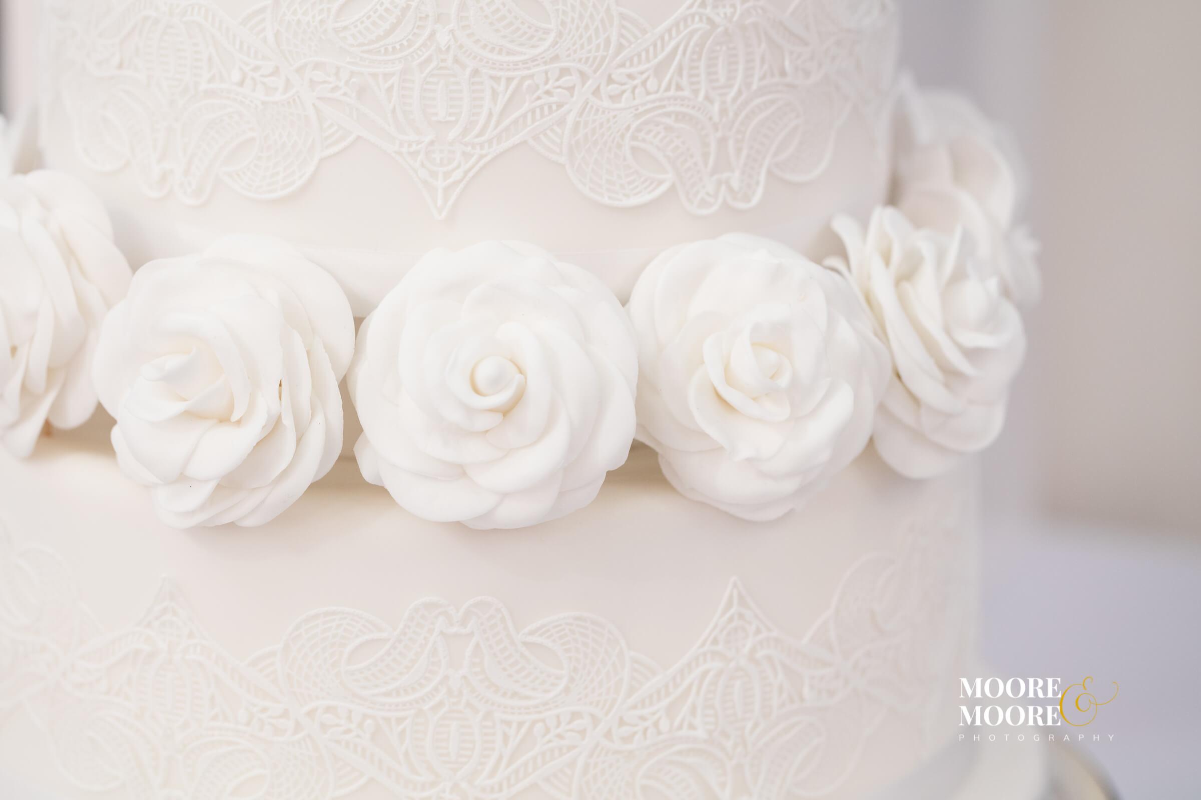elegant wedding cake with white roses, wedding photos by Hampshire Wedding Photographer, Helen Moore of Moore&Moore Photography