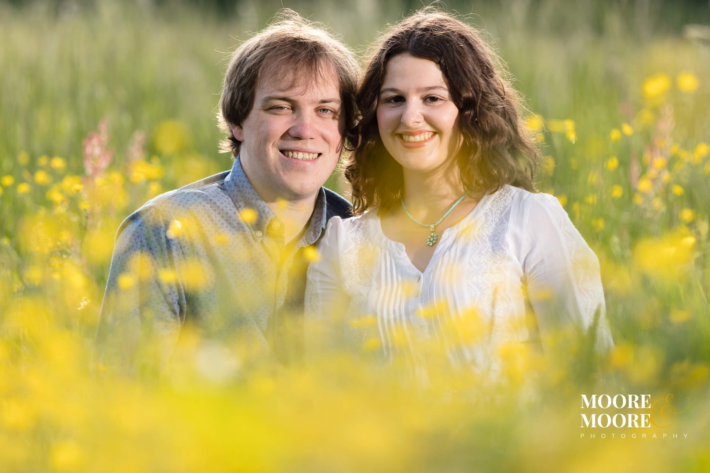 Amongst the buttercups, romantic engagement shoot in Hampshire by moore&moore photography