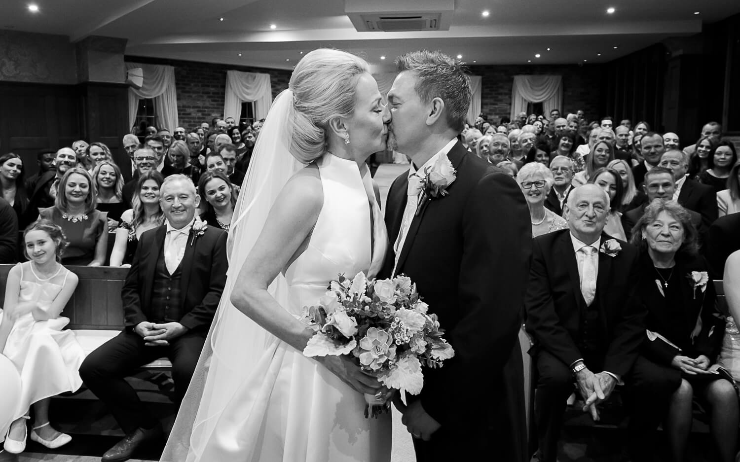 The Kiss at Wedding ceremony. Wedding Photos by Moore & Moore Photography, Hampshire