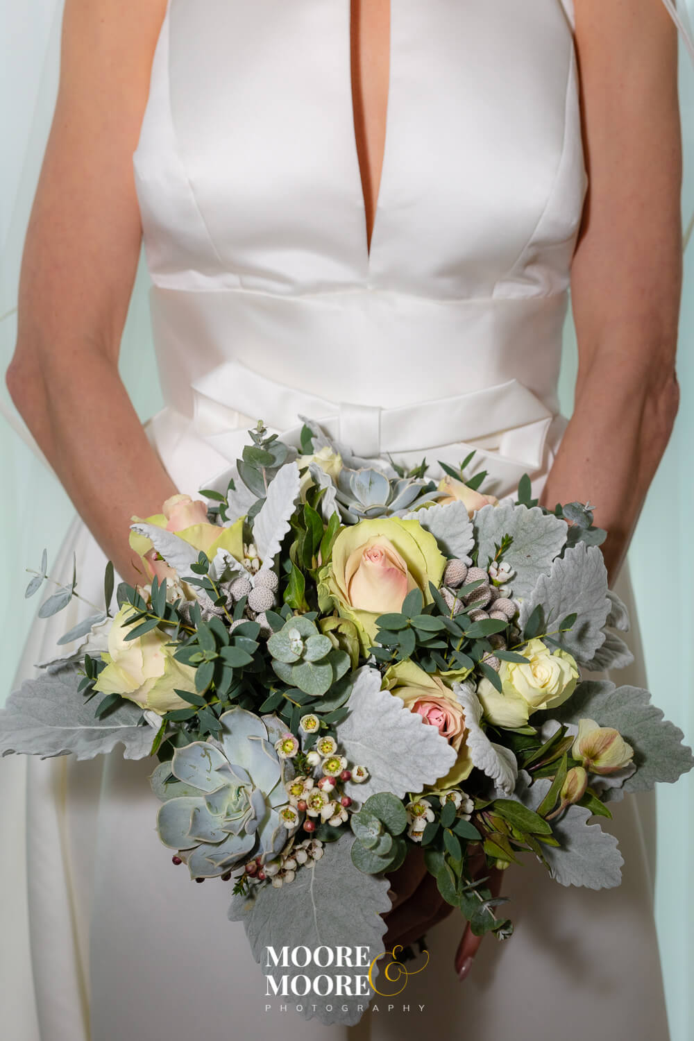 Bride holding bouquet. Wedding Photos by Moore & Moore Photography, Hampshire