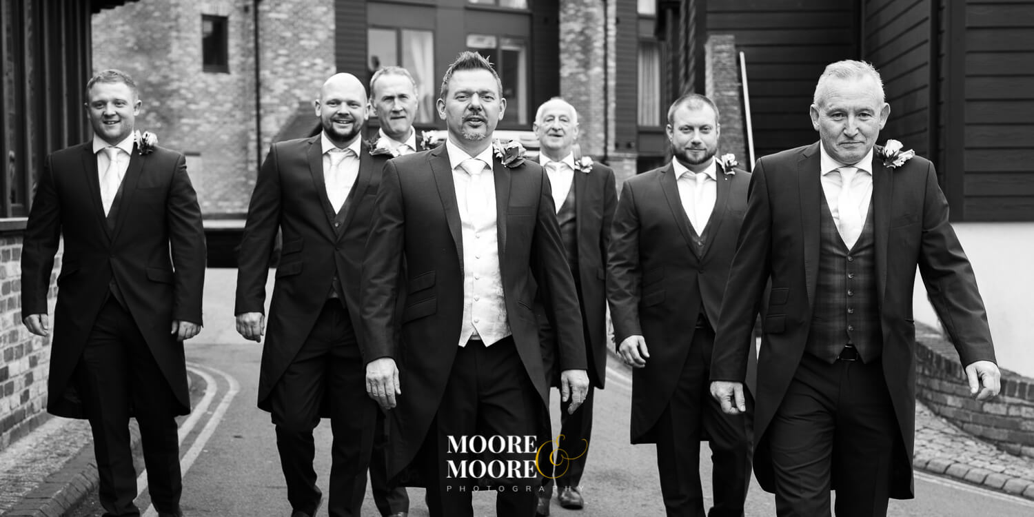 Groomsmen portrait Reservoir Dogs style. Wedding Photos by Moore & Moore Photography, Hampshire