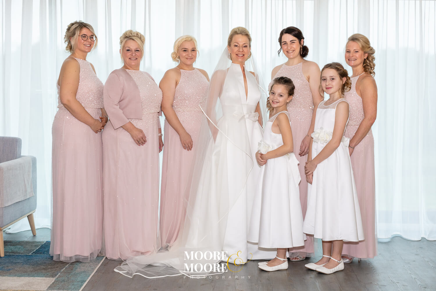 Bride and bridesmaids portrait photo. Wedding Photos by Moore & Moore Photography, Hampshire