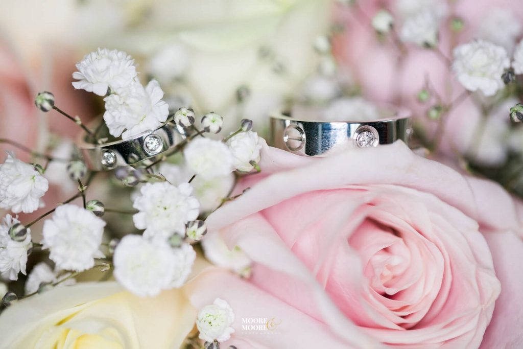 Bouquet and wedding rings. Tylney Hall Wedding Photography by Moore & Moore Photography, Hampshire