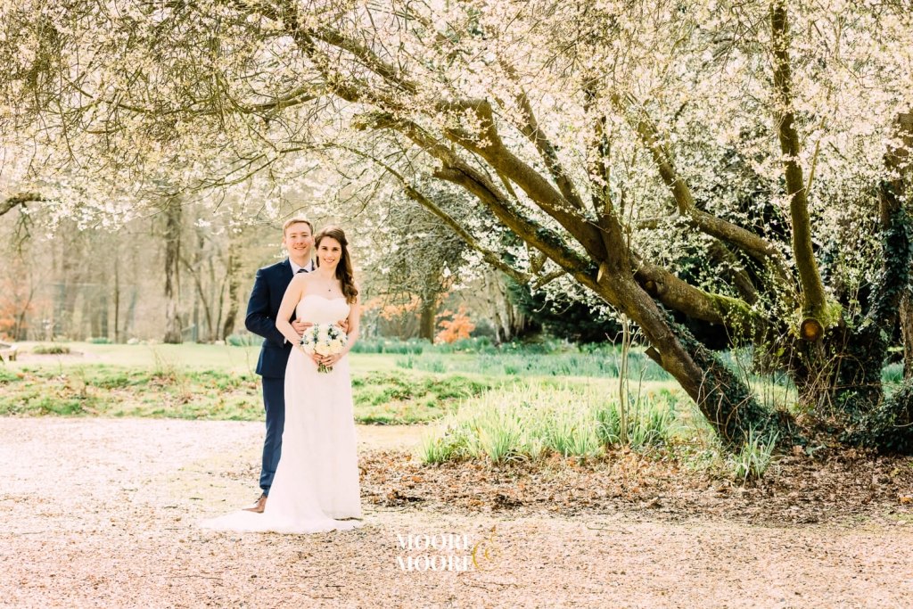 Beautiful blossom wedding photos. Farnham House Hotel Wedding Photography by Moore & Moore Photography, Fleet, Hampshire