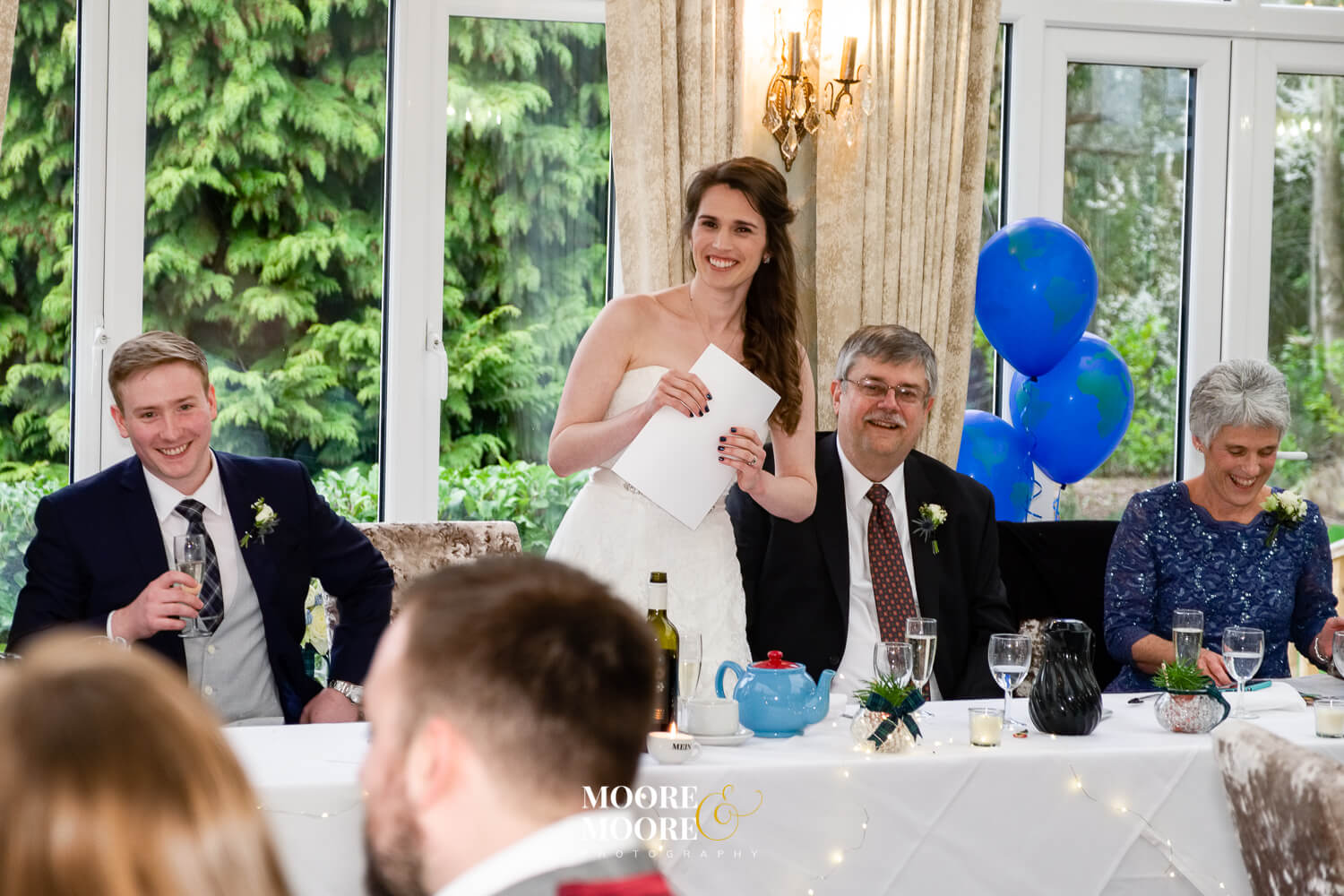 Wedding speeches by the bride. Bride & Groom photos. Farnham House Hotel Wedding Photography by Moore & Moore Photography, Fleet, Hampshire