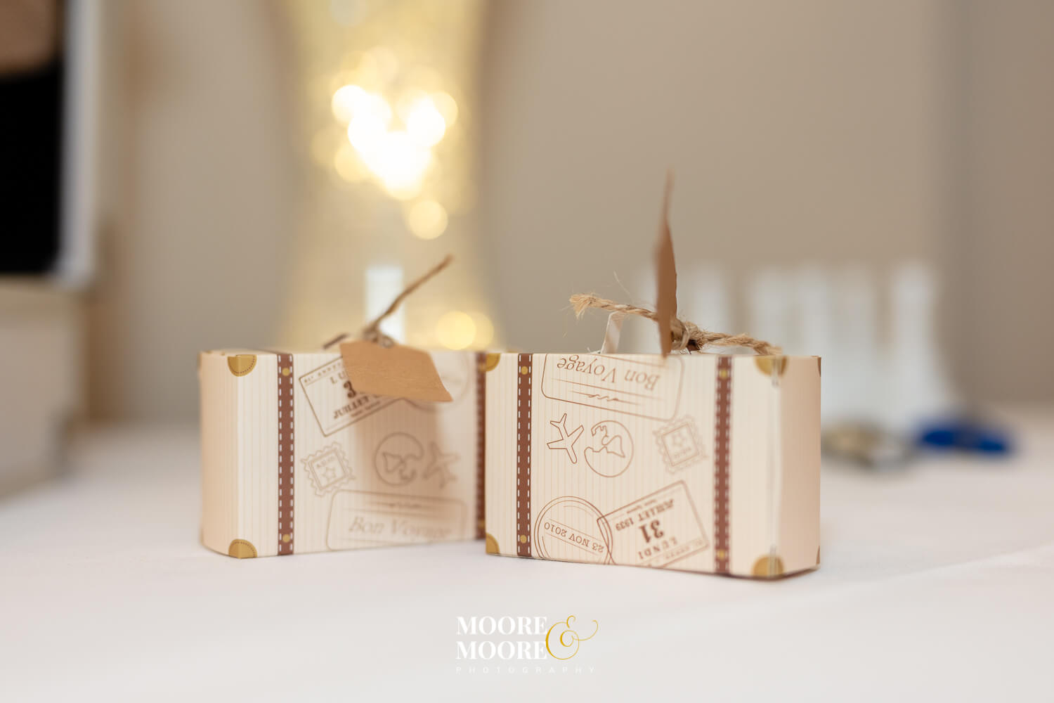 Wedding favours, mini suitcases. Bride & Groom photos. Farnham House Hotel Wedding Photography by Moore & Moore Photography, Fleet, Hampshire