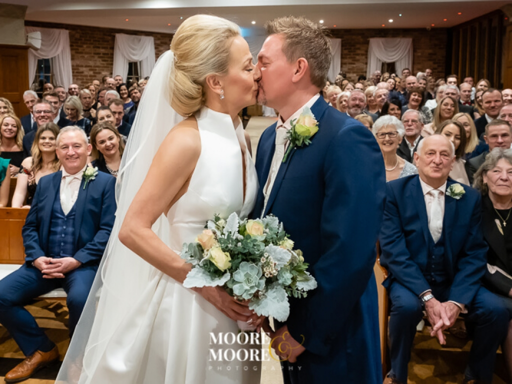 top-must-have-wedding-photos-first-kiss-of-bride-and-groom